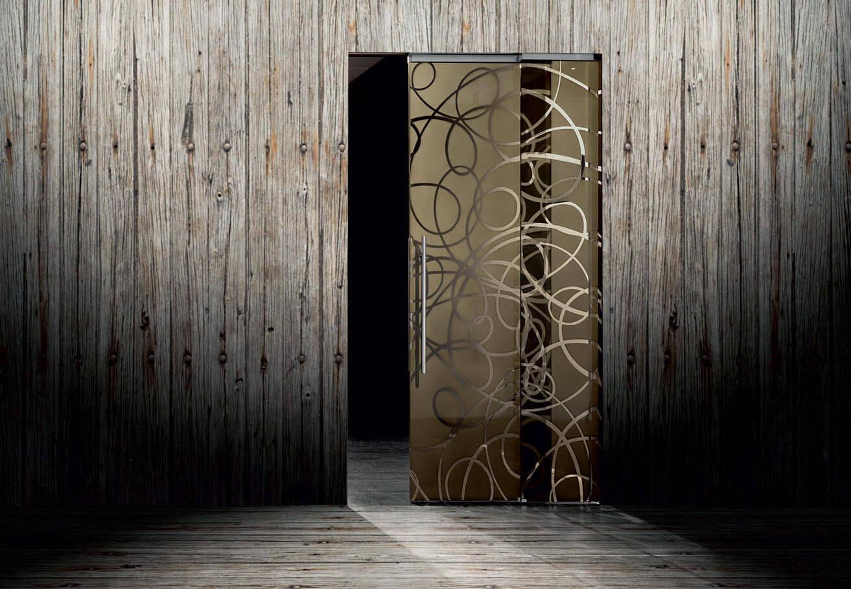 SVAI_porta scorrevole vetro filomuro decorata oro